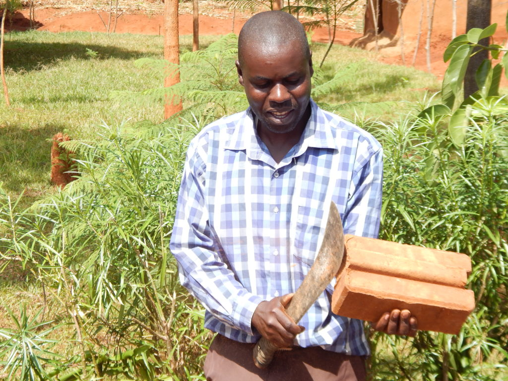 Ben Alemu, an artisan displays an interlocking brick