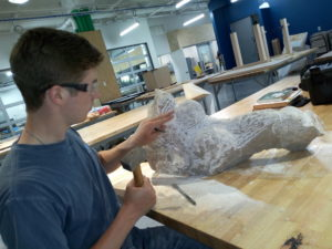 Dana Hoppe: A student at the University of Nebraska-Lincoln, works on his stone sculpture at the Nebraska Innovation Studio. PHOTO: LILIAN KAIVILU
