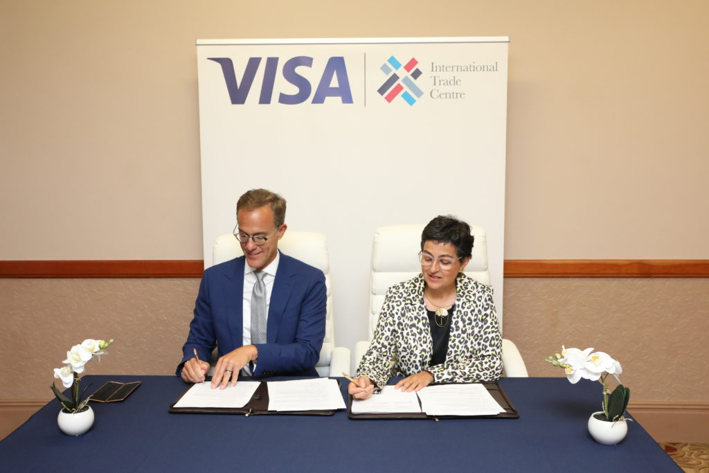 Ambassador Demetrios Marantis, Senior Vice President & Head, Global Government Engagement at VISA and Ms. Arancha González Executive Director International Trade Centre signing MOU to empower women-led businesses to trade globally at the 28th World Economic Forum.