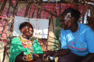 Lenantari talks to a mother during a medical outreach in Resim Village, Samburu East. PHOTO: IMPACTHUB MEDIA