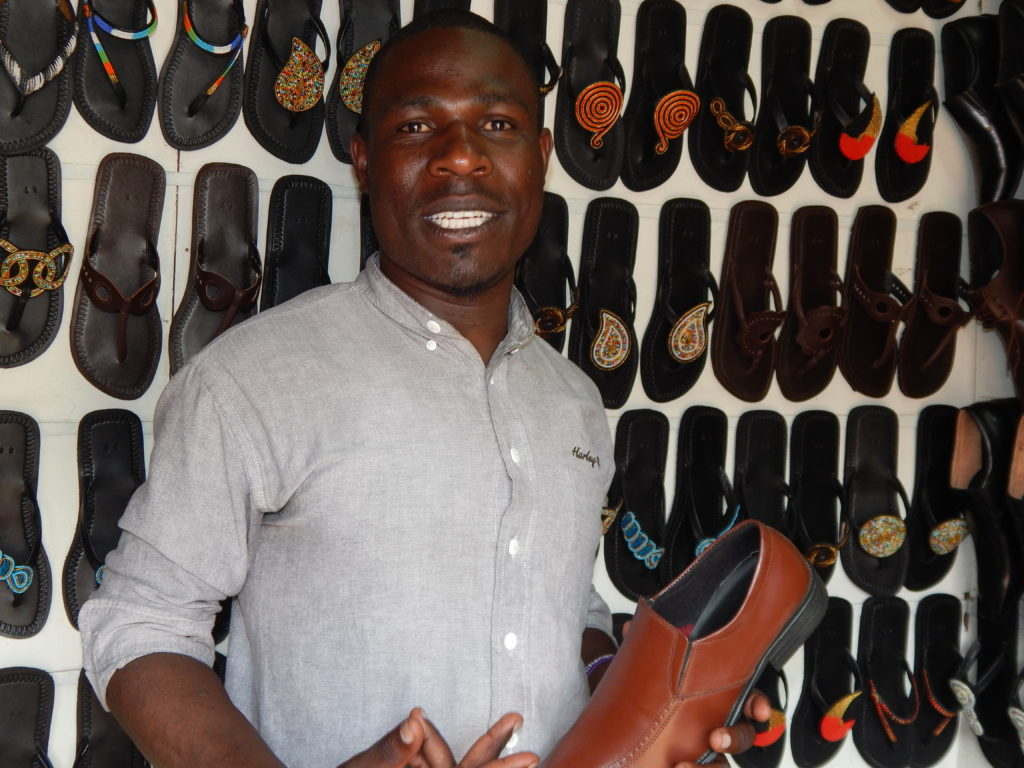 Julius Okoth Otieno, founder and CEO of Reafric social enterprise, an organization that recycles industrial waste to make shoes for sale.