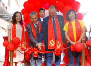 Counsellor of Chinese Embassy to Kenya, Wang Xuezheng (left) and with Two Rivers Lifestyle Centre's General Manager, Mr. Theodoros Pantis (right) officially cuts the ribbon as they mark Chinese new year 2020. Looking on from left is Erdemann Chinese school board member, Ms. Zhang Jing, Chi Yang Head of Erdemann school and Director of Confucius Institute at the University of Nairobi, Prof. Xiao Shan.