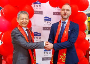 Counsellor of Chinese Embassy to Kenya, Wang Xuezheng interacting with Two Rivers Lifestyle Centre's General Manager, Mr. Theodoros Pantis as they shake hands after marking the Chinese new year 2020.