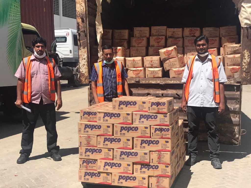 Pwani Oil Operations Manager Personal & Home Care Sim Moonesawmy (centre) poses with Hussein Kasmani- Executive Logistics and loading supervisor Yusuf Mohamed (right) before dispatching donations to families in Kilifi County.