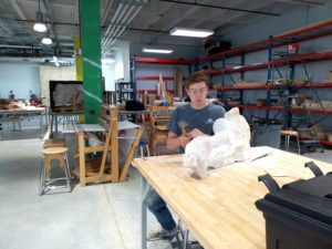 Dana Hoppe, a student at the University of Nebraska-Lincoln works on his stone sculpture at the Nebraska Innovation Studio.