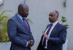 Dr Frank Njenga confers with Janssen Country Manager Mr. Marseile Onyango during the launch of Paliperidone Palmitate for the treatment of schizophrenia.
