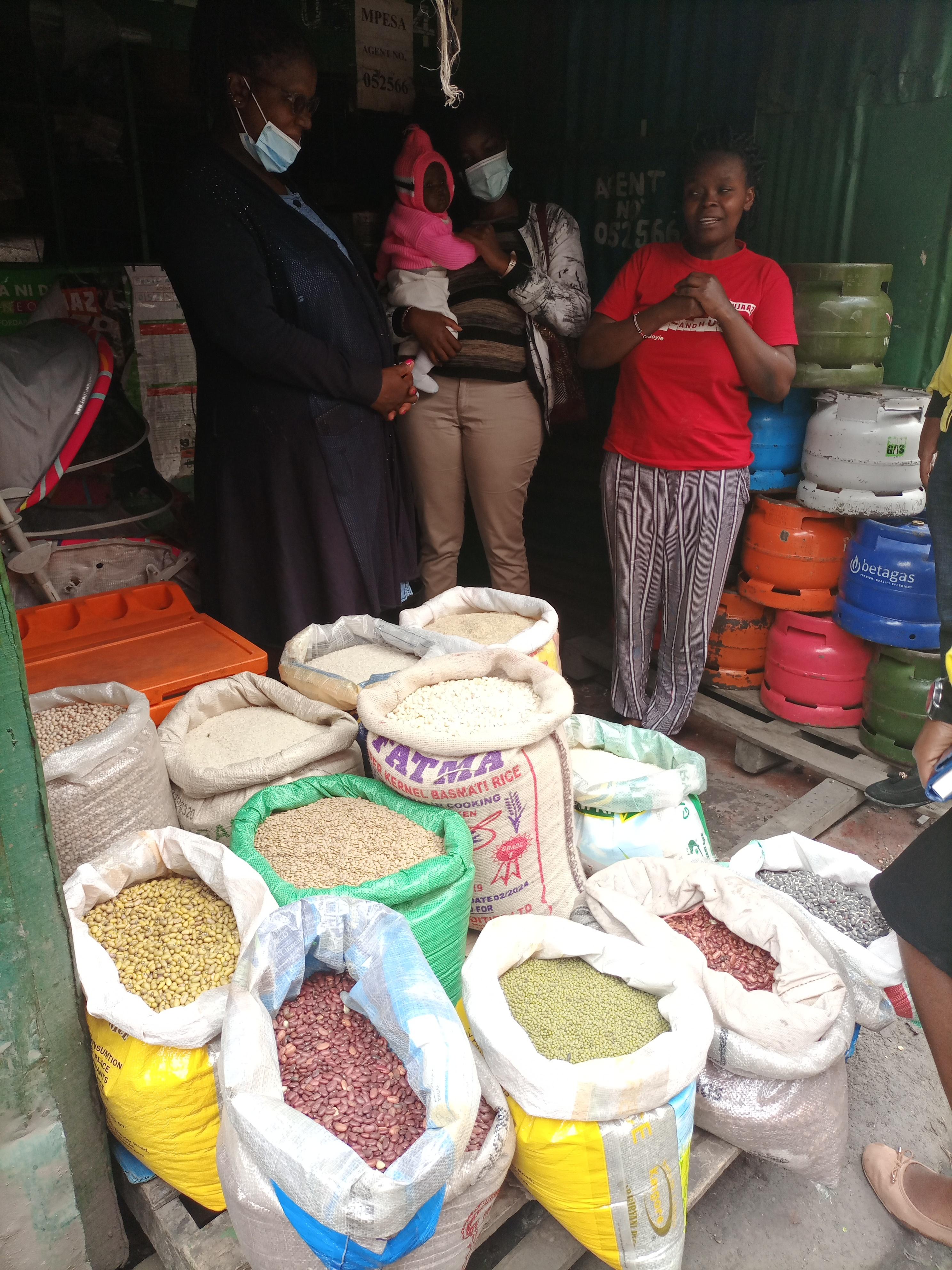 Wangari at her retail shop talking about using Sarafu to trade