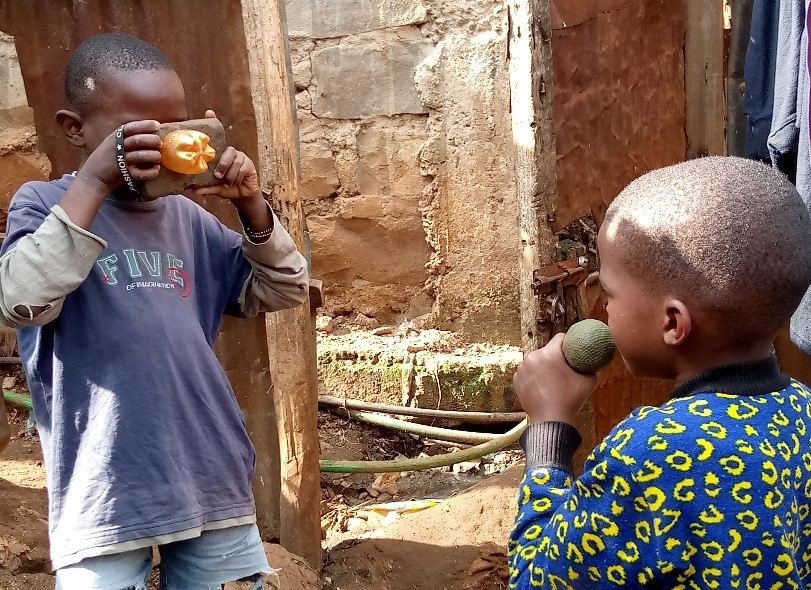 These children have made dummy cameras and a microphone out of clay. They use these gadgets they use to sensitise people about covid-19. PHOTO: Judy Ndunge/Impacthub Media