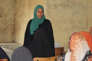 Mulki Mohamoud addresses girls during a mentorship session. PHOTO/IMPACTHUB MEDIA