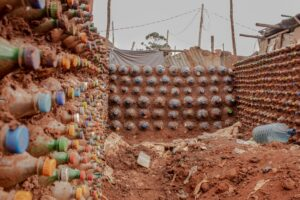 A section of a wall in Kibra made using recycled bottles. Photo: Ismael Photography