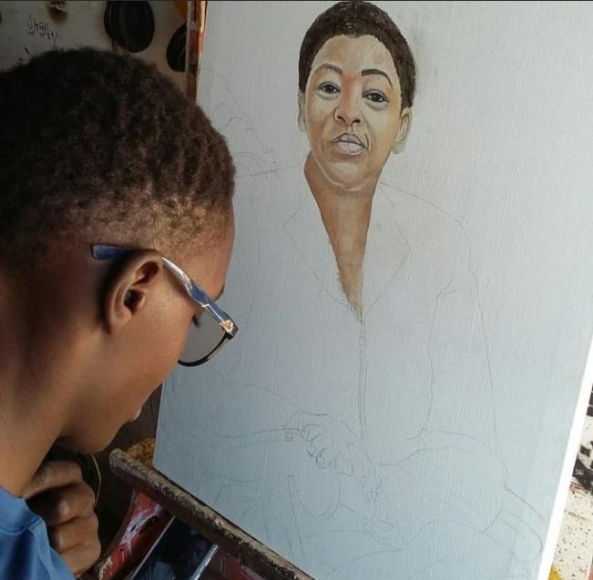 An artist at Nyota Art Gallery finalises on an artwork