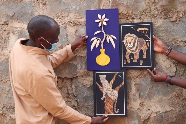 Harrison Wanguku delivers some art pieces to a customer in Kiambu, Kenya, on behalf of his teenage son John Karuga/IMANI BAHA