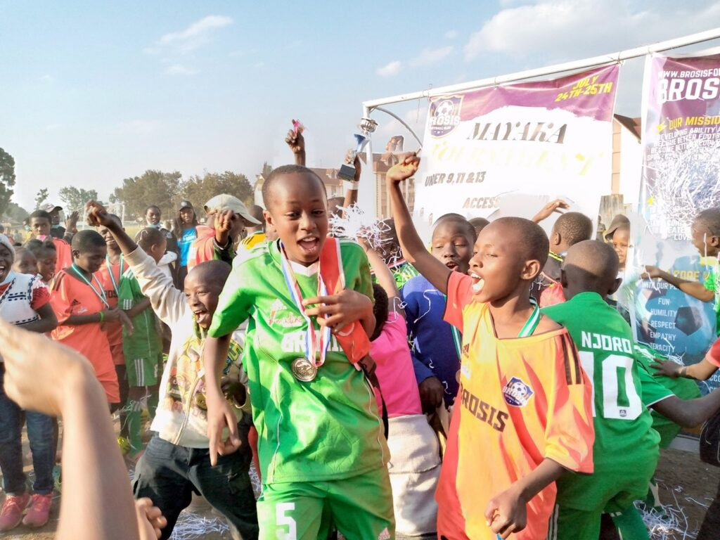 Brosis FC celebrating after winning two awards in a tournament