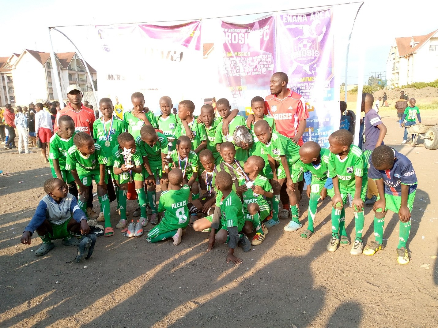 Brosis under 9years team with their Coach (right) and their founder (right) in award photo